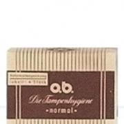 Imagem de uma versão antiga das embalagens de Tampões o.b.®. É amarela e castanha às riscas.